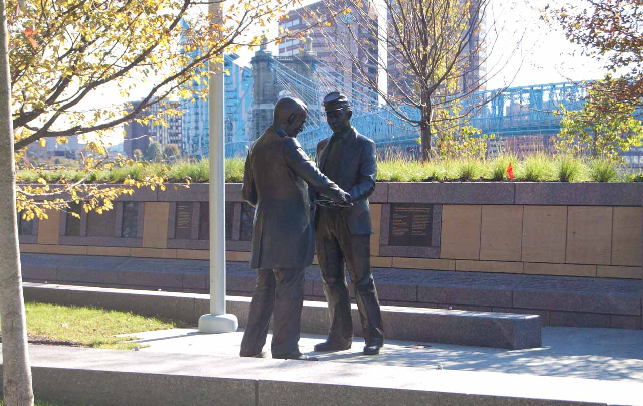 Bronze statue of two men at the Black Brigade monument