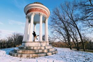 Cincinnati date idea: A couple hugging under the Temple of Love in Mt. Storm park on a snowy day